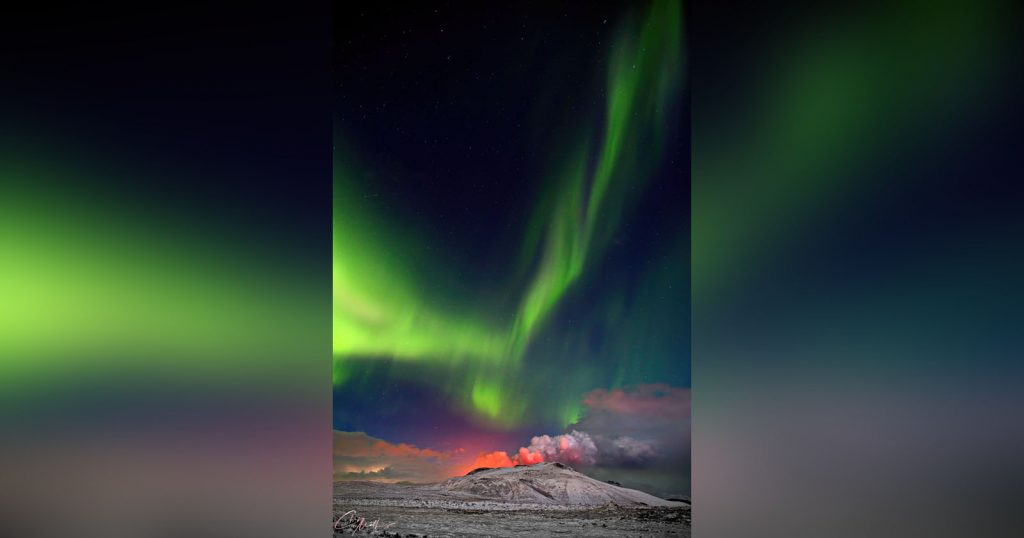 Photographer Captures Aurora Over Iceland's Erupting Volcano